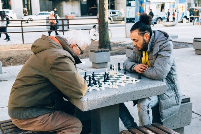 Two people playing chess outdoor