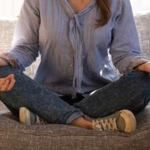Mom meditating to declutter her mind