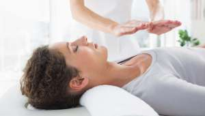 Woman receiving a Reiki Healing Session