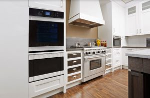 Modern kitchen design with mirrored cabinets.