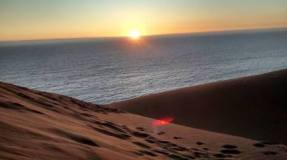 Sand dunes and sunset at Renaca Beach in Chile