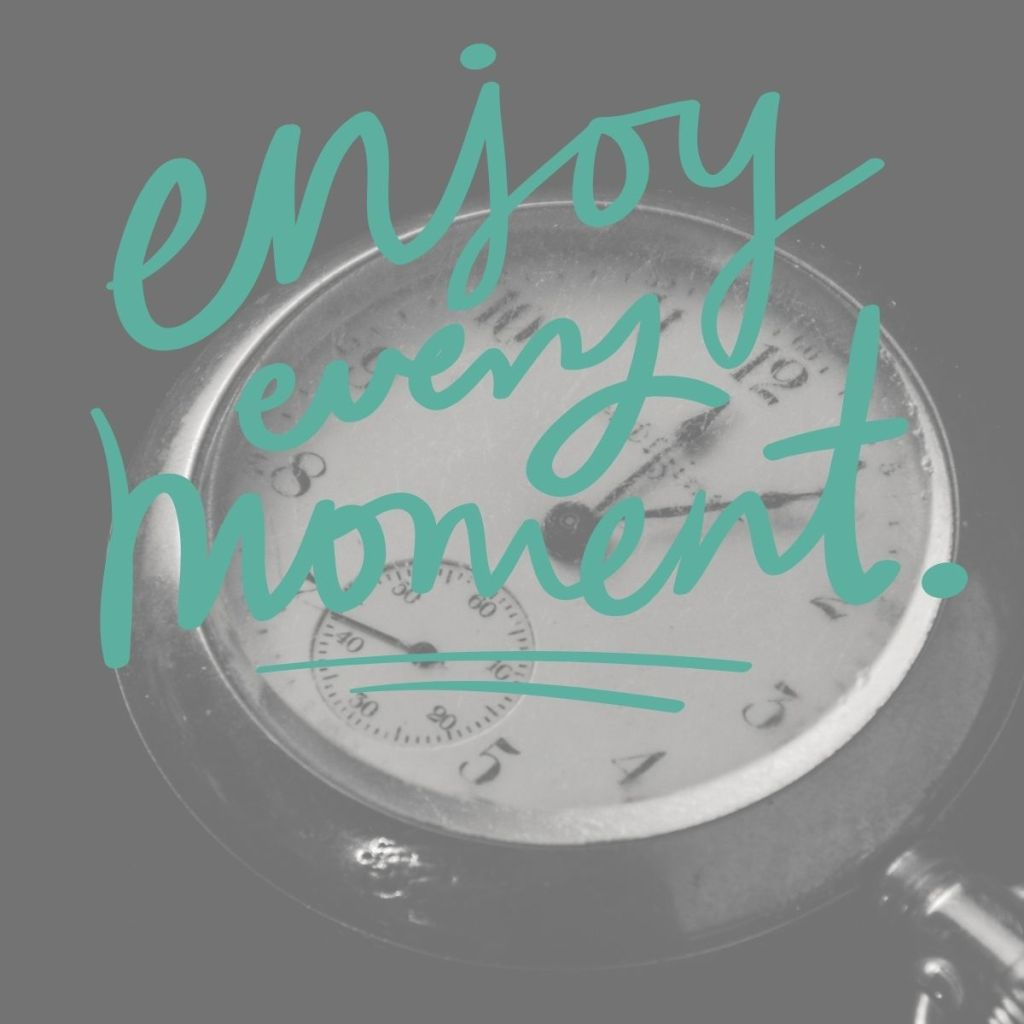 Enjoy the moment image with a clock in the background