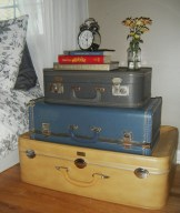 Stacked suitcases turned bedside table