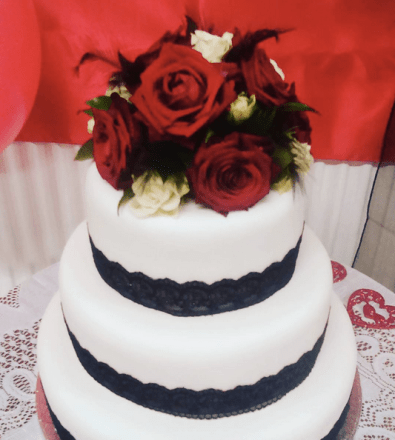 royal icing wedding cake with fresh flowers