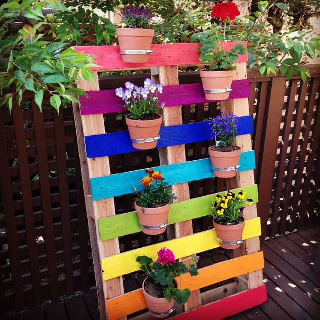 Create-a-bright-and-colorful-upcycled-rainbow-pallet-planter-project-with-these-simple-instructions-from-Hello-Creative-Family.-A-great-family-weekend-project-that-kids-will-love.