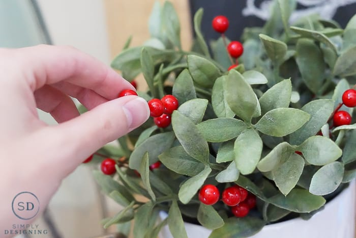 add berries to greenery for holiday touch