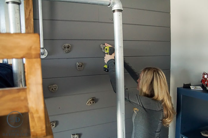 Install Rock Climbing Grabs on a Grey Shiplap Style Accent Wall