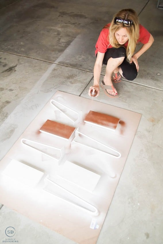 paint parts for diy end table with metallic copper spray paint