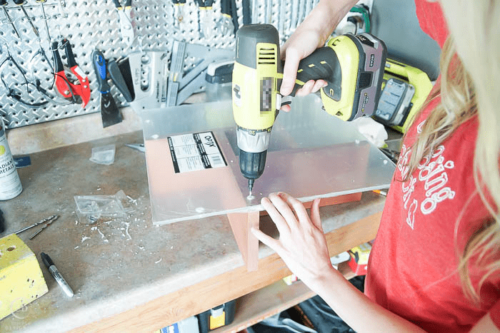 drill pilot holes into table