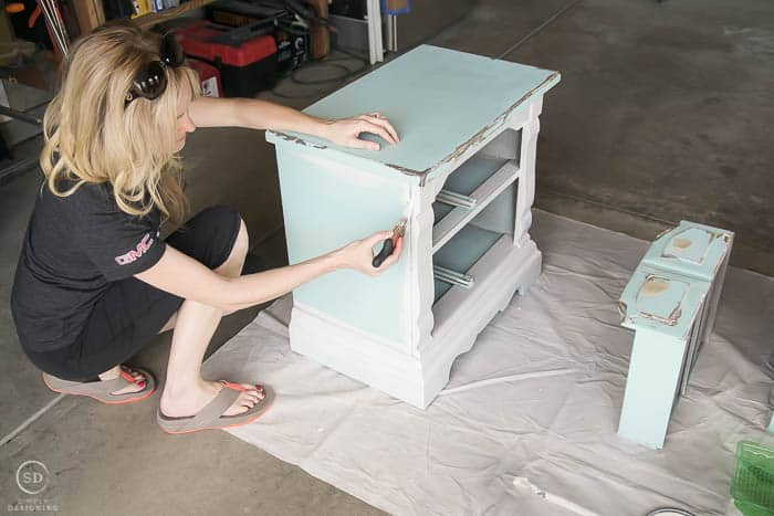 Use a brush to paint in corners and edges to re-paint bedside tables