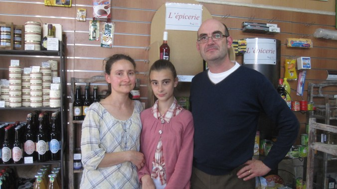 Proud owner with family of the Épicerie