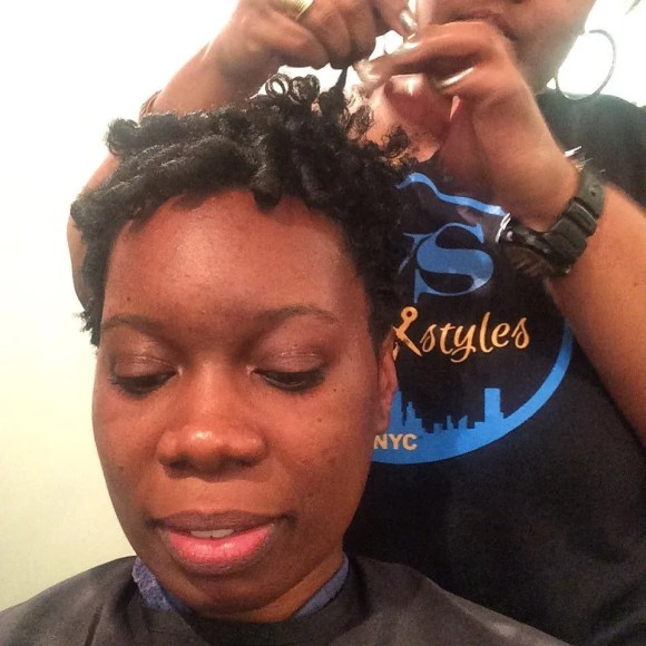 Wesley Styles separating and styling natural coils