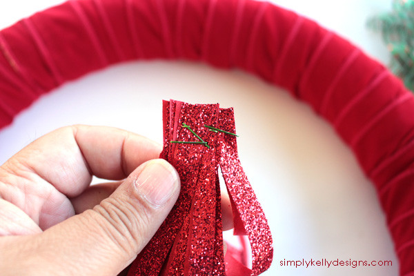 Create this easy jingle bell wreath that will look great on your door and provide you with some festive holiday jingles.