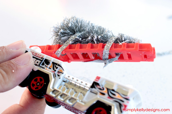 Create this DIY jingle bell fire truck ornament for a fire fighter or to add some festive bling to your Chrsitmas tree