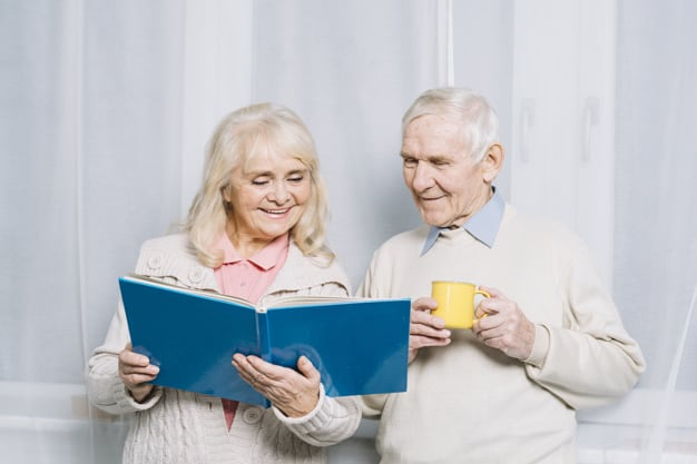 Old couple reading a book - Never stop learning