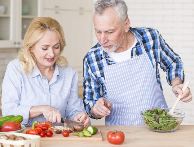 Senior man helping his wife