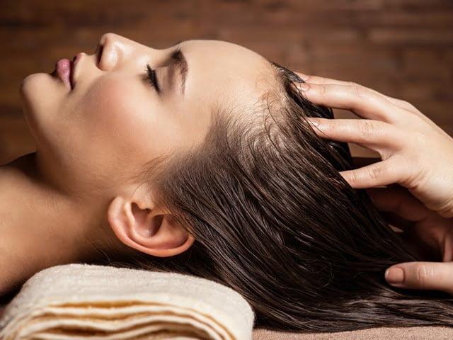 Hair care tips scalp massage woman