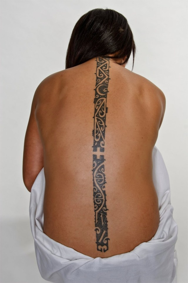 fine line on back maori tattoo