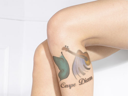 carpe diem tattoo on calf muscle