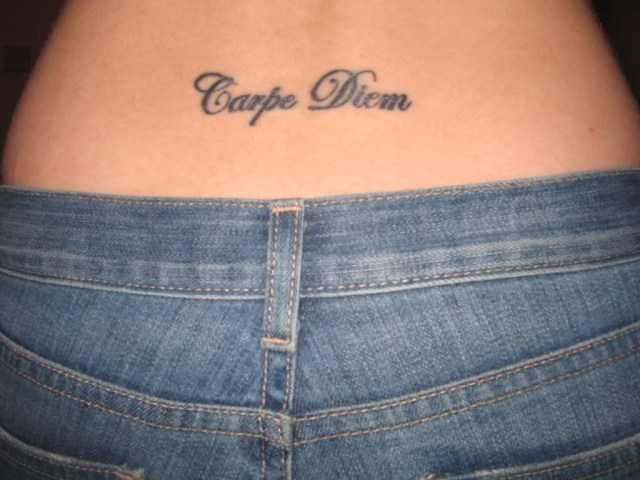 carpe diem tattoo on lower back