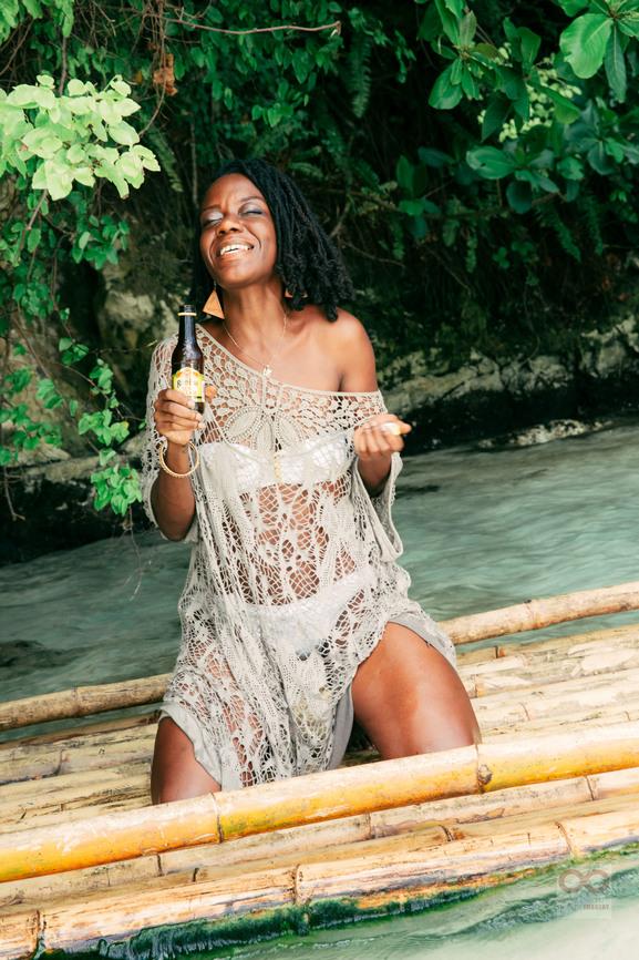 woman in tropics holding Rumbar on a raft