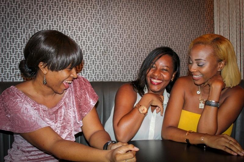 3 black women laughing