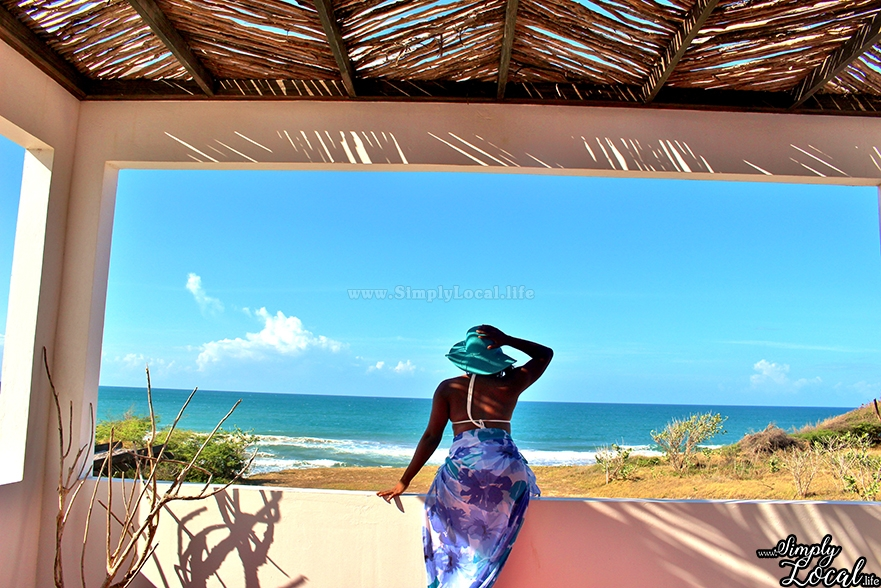 Turtles Nest Treasure Beach Jamaica Villa woman with hat by the beach