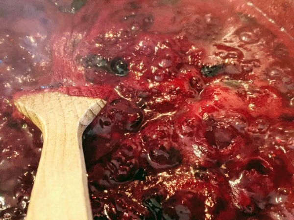 stirring blueberry jam