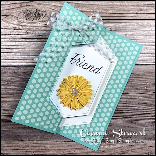You can make someone's day with this delightful yellow daisy on front of a creative swinging card.