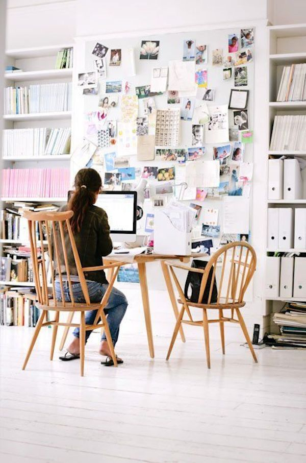Floor To Ceiling Bookshelves and Bulletin Board// 12 Creative Spaces for the Organized Artist // simplyspaced.com