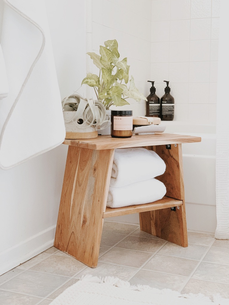 Image of bathroom stool organized with towel and bath essentials