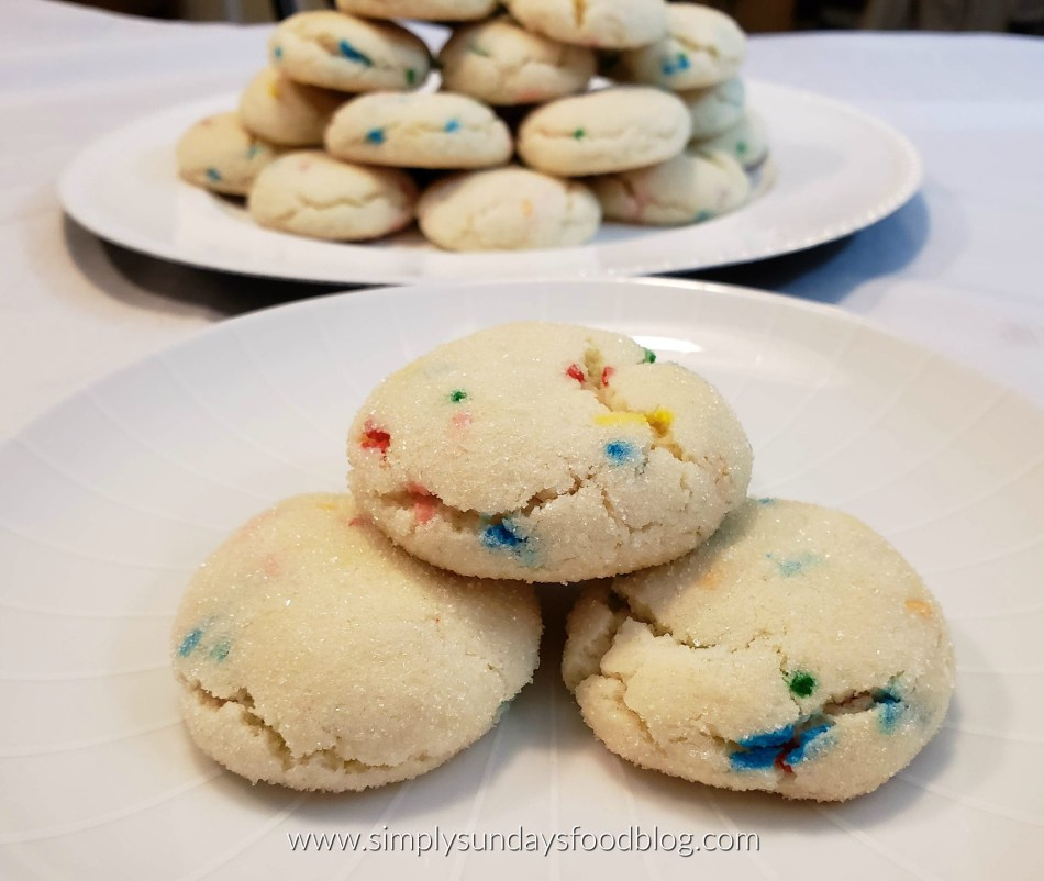 A plate of funfetti cookies sparkling with sugar and colorful sprinkles