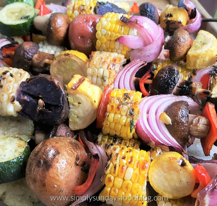 Grilled corn, onions, mushrooms, potatoes and zucchini on wooden skewers