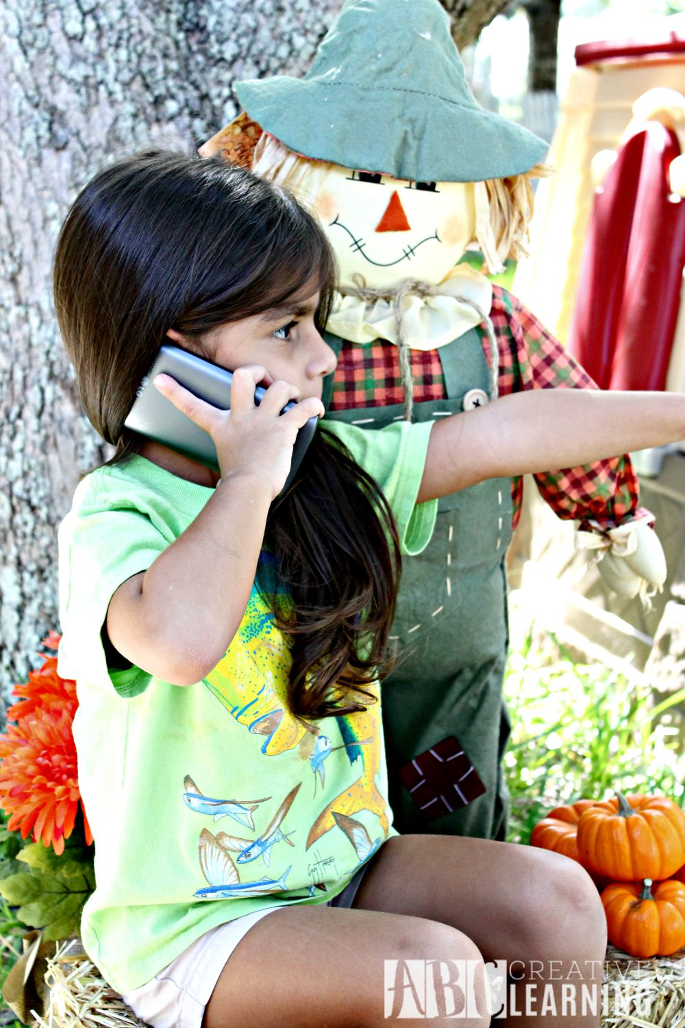 7 Tips When Visiting a Pumpkin Patch or Fall Festival with the Family with phone