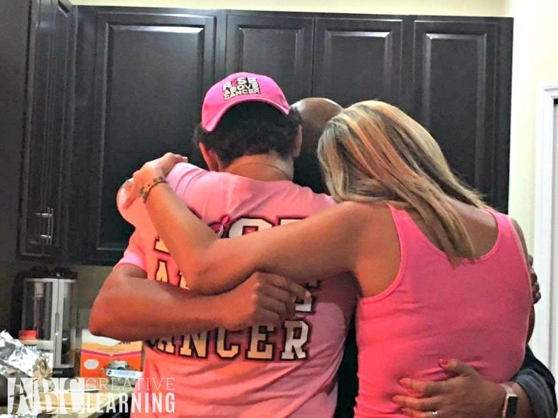 My family had a surprise breast cancer party for me before starting chemo. I'm in the middle surrounded by all of my siblings!