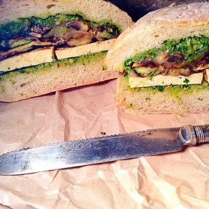 BBQ tofu and grilled vegetables with kale pesto sandwich