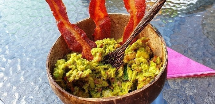 Homemade guacamole with streaky bacon