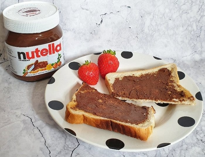 A Happy Portion of Nutella on toast with strawberries