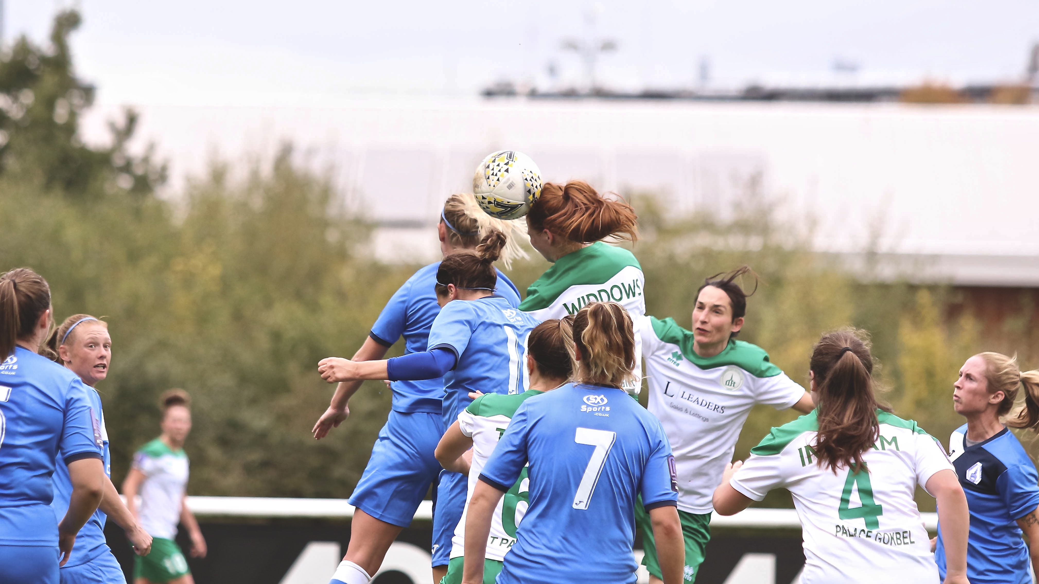 Jade Widdow leaps for a header