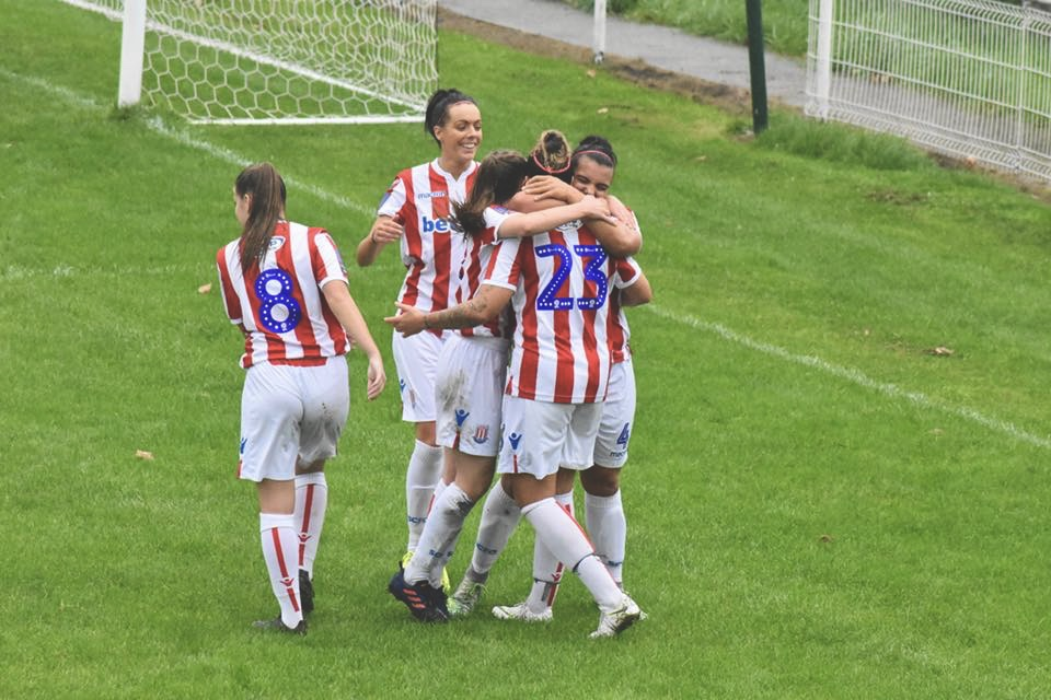 Faye is mobbed by her Stoke City team mates after scoring.