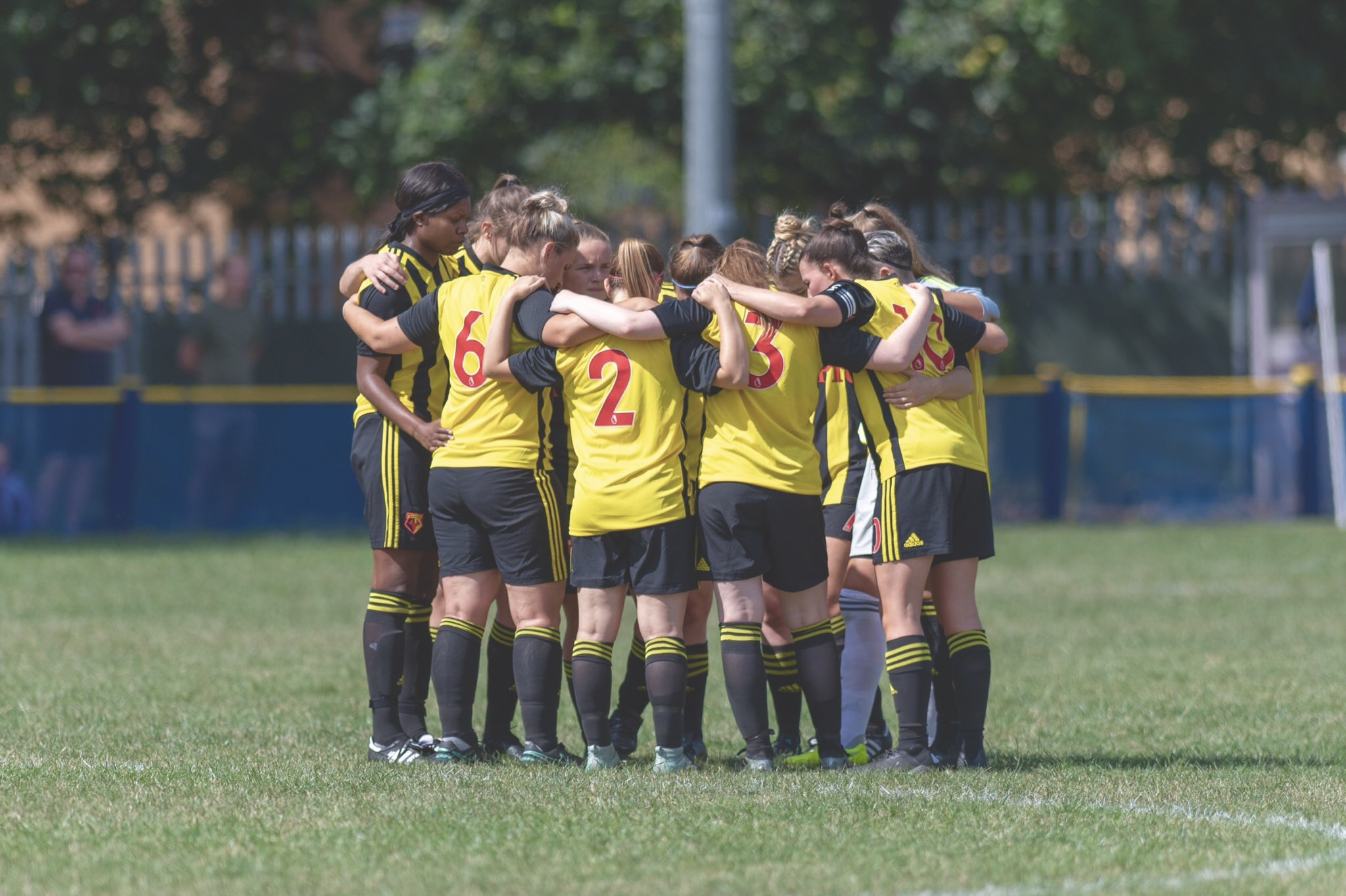 Watford FC Ladies in a group huddle. Taken by Andrew Waller Images.