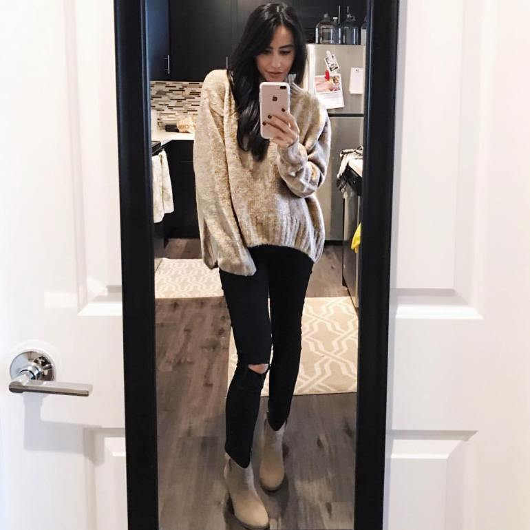 wardrobe essential ankle boots with oversized knit sweater and ripped jeans