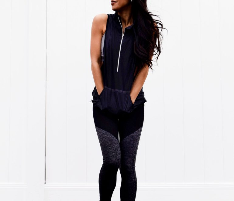 under armour hooded vest, color block leggings, rose gold nikes