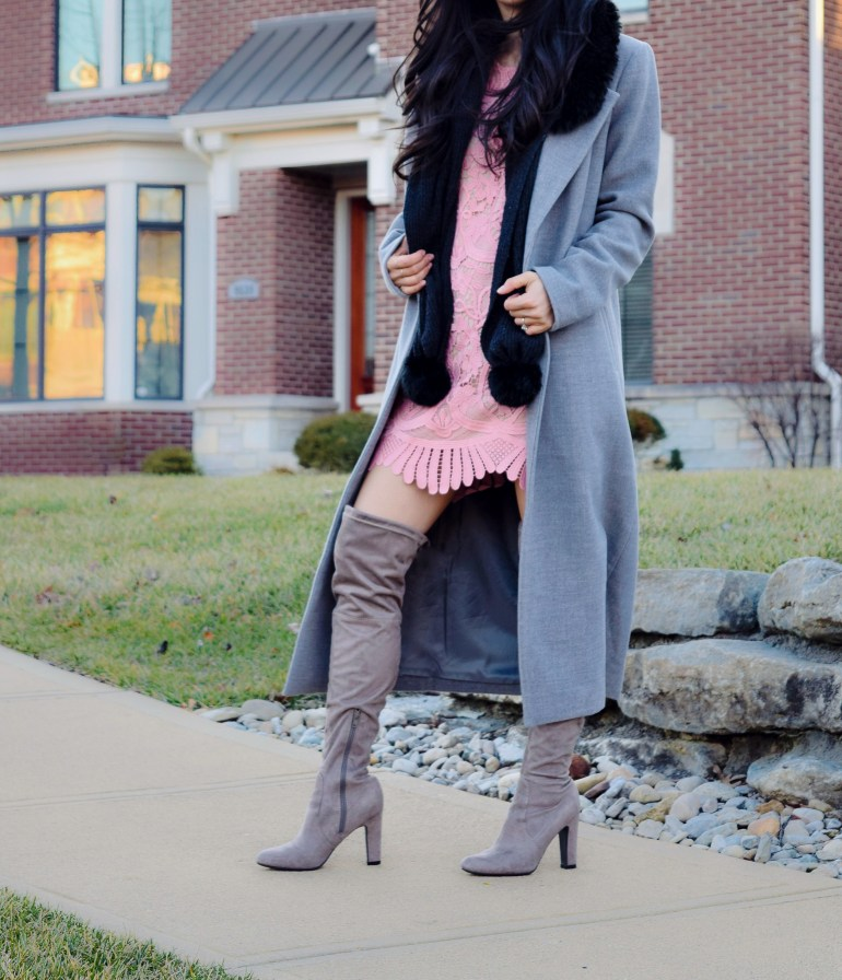 lace detail shift dress in pale pink, light grey duster coat and over the knee boots, black pom scarf