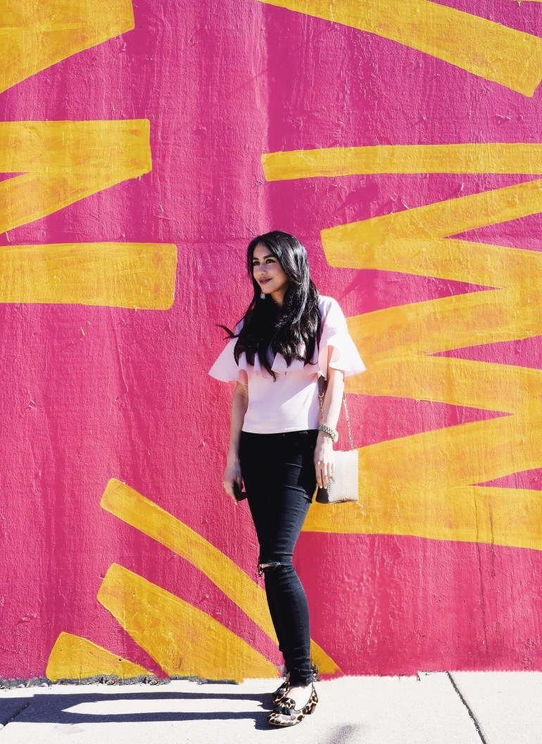 pastel pink ruffle tee, black denim, leopard loafers, taupe bag chicago mural