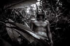 The Shaman: Siberut Island, Mentawai, Indonesia. Aman Masit Dere, is a medicine man or Sikerei of the indigenous tribal community that inhabit the inland jungles and mountains of the Mentawai islands west of Sumatra, Indonesia. His leathery skin is covered in tattoos and his lean muscular physique is emblematic of an uncompromising jungle life. Until now he has managed to reject modern influence and instead continues to capitalize on an in-depth knowledge of the jungles foods, medicines and building resources, but the Mentawai existence is at the mercy of significant cultural, behavioural and ideological change. A change, brought about by the gradual introduction and influence of foreign practice that, evidently, is having an adverse effect; resulting in a significant decline in health, wellbeing and livelihood across the wider community. Photograph by Chris Hopkins © Chris Hopkins 2017
