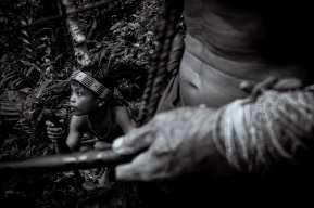 """Jumer: Siberut Island, Mentawai, Indonesia. Like his grandfather, nine year old Jumer possesses an inner light, a connection to the land and forest, the knowledge that this is his place. When asked if he would like to go to school with the others Jumer doesn't hesitate: """"No"""". Like those before him, he learns all he can and all the Mentawai have ever needed to know – until now – from observing his elders and listening to the lessons of the Sikerei. Photograph by Chris Hopkins © Chris Hopkins 2017"""