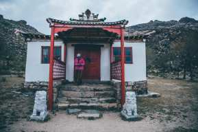 After a ride for 6 hours we saw these mountains and this little temple. A woman was busy cleaning the outside. We entered her space and she opened the door of this temple. The inside and her story surprised me.
