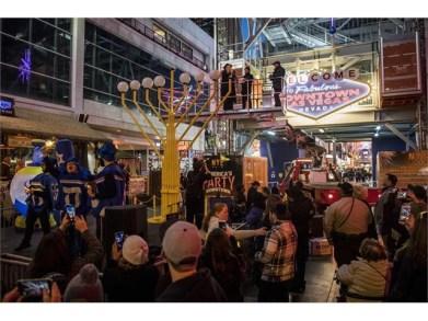 Rabbi Shea Harlig lights the Grand Menorah