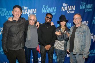 ANAHEIM, CALIFORNIA - JANUARY 18: Sam Hollander, Danny Kortchmar, Troy Noka, Linda Perry and Steve Baltin attend The 2020 NAMM Show on January 18, 2020 in Anaheim, California. (Photo by Jerod Harris/Getty Images for NAMM)